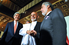 U.S. Secretary of State John Kerry stands with Afghan presidential candidates Ashraf Ghani, left, and Abdullah Abdullah, right, at the United Nations Mission Headquarters in Kabul, Afghanistan on July 12, 2014, after they told reporters about the details of an agreement on a technical and political plan the Secretary helped broker to resolve the disputed outcome of the election between them. [State Department photo/ Public Domain]