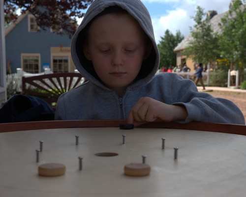 Playing crokinole