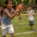 young-girl-running-with-ball-empower-2-play