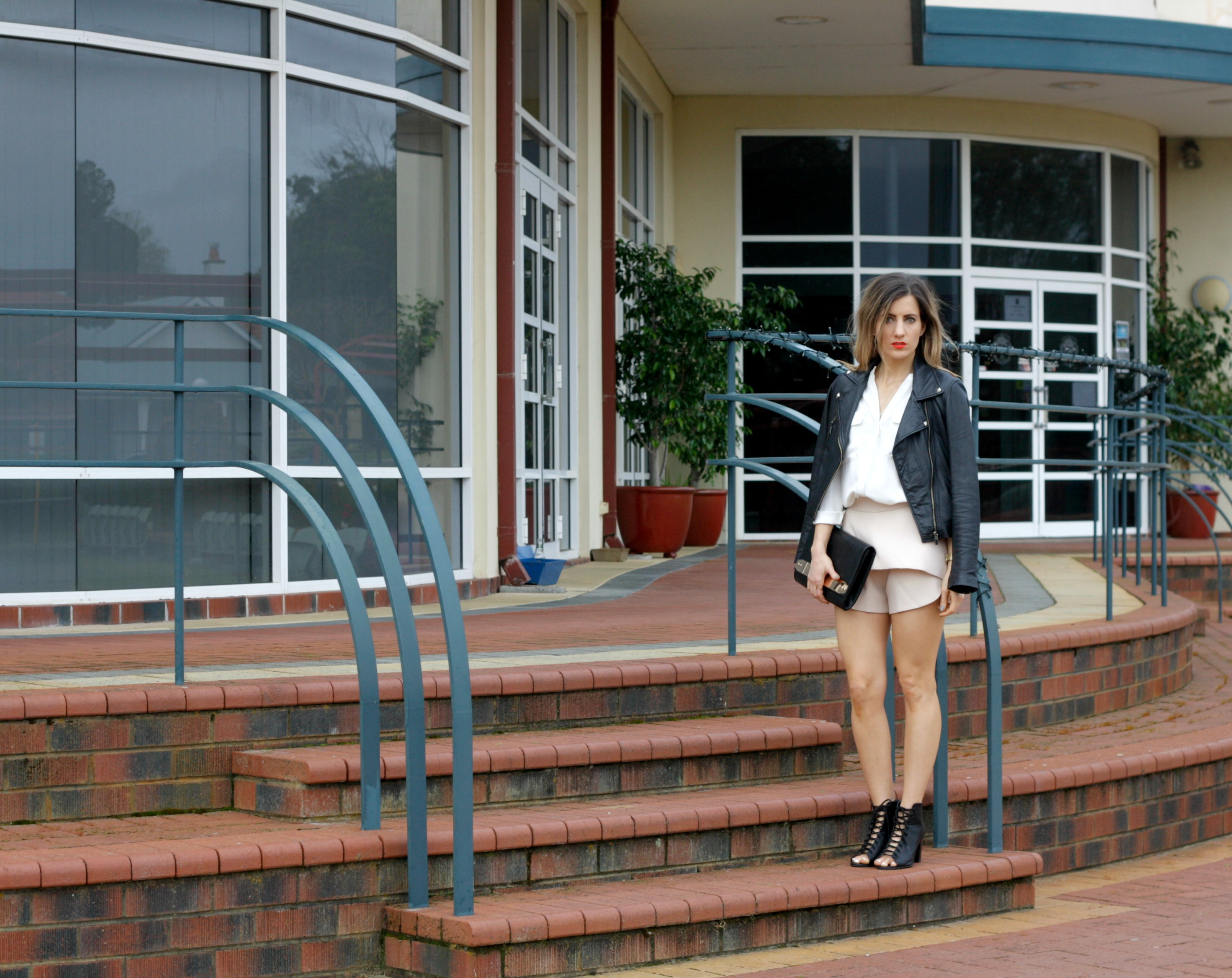 fashion blog outfit post featuring Hello Parry nude skort