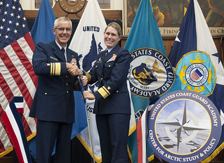 U.S. Coast Guard Vice Commandant Vice Adm. Peter Neffenger and Coast Guard Academy Superintendent Rear Adm. Sandra Stosz officially establish the Center for Arctic Study and Policy with a ribbon-cutting ceremony Sept. 19, 2014. U.S. Coast Guard photo by Petty Officer 2nd Class Cory J. Mendenhall.