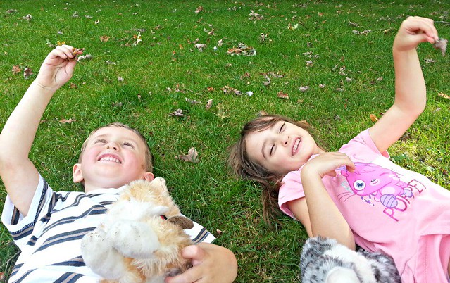 Lying on the grass, laughing children, children get messy