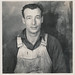 Small photo of Portrait of a man in overalls