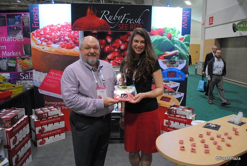 "Seen here are David Anthony and Antonia Praljak of Oro Loma Ranch/Ruby Fresh Pomegranate. They are proudly promoting their new ""Salad Jewels"" product line, which was introduced at the 2013 Canadian Produce Marketing Association (CPMA) trade show."