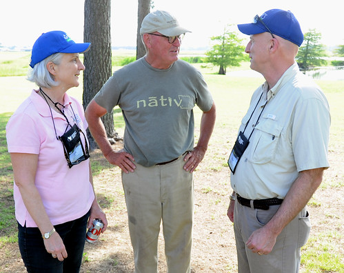 Ann Mills, USDA Deputy Under Secretary for Natural Resources and Environment, and Mike Sullivan, USDA Natural Resources Conservation Service state conservationist in Arkansas, visit with David Felke about water quantity and soil health. (NRCS photo by Reginald L. Jackson)