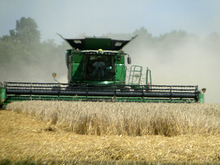 Picture of a harvester in a field with heat rising from the field