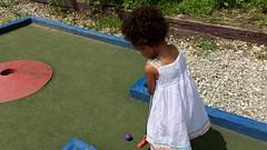 lawn(0.0), playground(0.0), child(1.0), grass(1.0), play(1.0), sports(1.0), recreation(1.0), outdoor recreation(1.0), leisure(1.0), miniature golf(1.0), toddler(1.0),