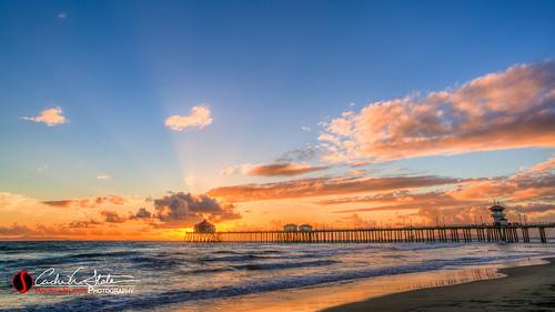 california sunset orange sun beach clouds canon landscape pier sand unitedstates ies pacificocean rays orangecounty huntingtonbeach hdr annualconference photomatix huntingtonbeachca 5dmarkiii