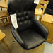 Black leatherette armchair