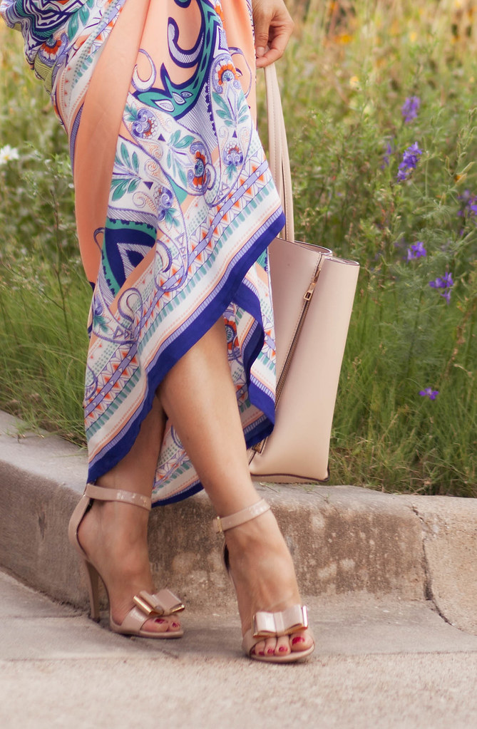 cute & little blog | petite fashion | the mint julep boutique peach tribal printed maxi, nude bow strappy heels, nude tote, stella dot bardot spiral bangle, stella dot green sutton necklace | summer outfit