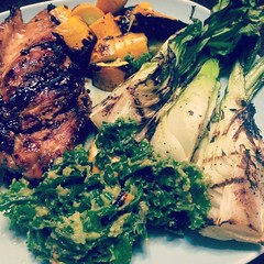 Dinner: teriyaki chicken, grilled bok choy & squash, raw kale salad with warm avocado & sweet potatoes tossed in French dressing & Sriracha
