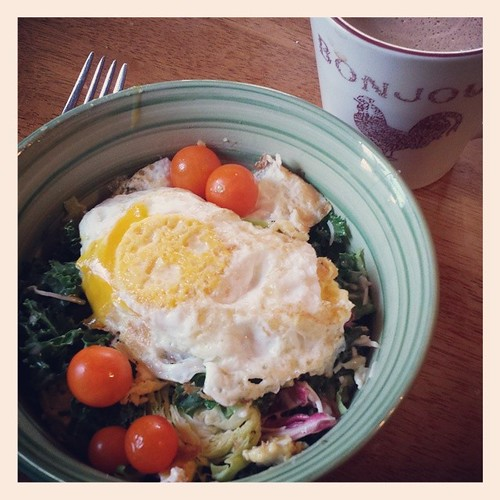 Breakfast salad Kale, Brussels sprouts,  cabbage, sungold tomatoes,  over-medium egg. #100saladsummer #food #summer #health