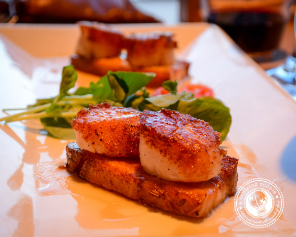... scallops expertly paired with sweet and thick maple glazed bacon