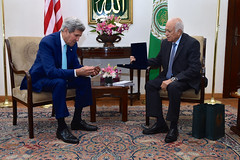 Arab League Secretary-General Nabil al-Araby presents a medallion to U.S. Secretary of State John Kerry at Arab League Headquarters in Cairo, Egypt, on July 22, 2014, before a discussion about a possible ceasefire between Israeli and Hamas forces fighting in the Gaza Strip. [State Department photo/ Public Domain]