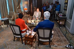 U.S. Secretary of State John Kerry and U.S. Commerce Secretary Penny Pritzker sit for a joint television interview with NDTV host Prannoy Roy in New Delhi between meetings during the U.S.-India Strategic & Economic Dialogue on July 31, 2014. [State Department photo/ Public Domain]