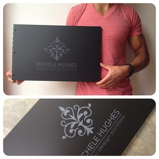 Custom graphic design portfolio book in matte black with engraved color fill treatment