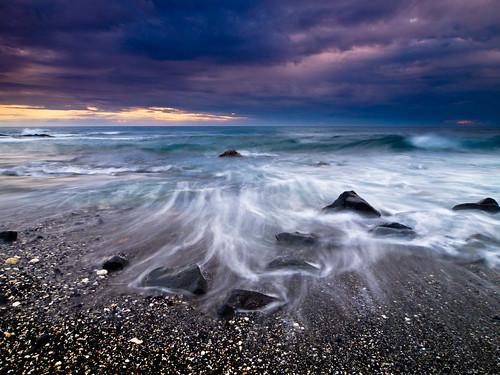 ocean sunset seascape storm beach clouds landscape blacksand hawaii sand shoreline scenic stormy slowshutter vista coastline bigisland otec kailuakona keahole watermovement fromhereonin nelha kohanaiki christopherjohnson getolympus hurricaneiselle