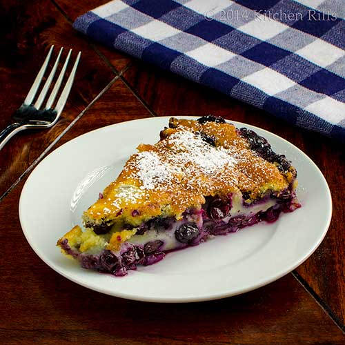 Blueberry Flaugnarde (Flan) with powdered sugar garnish