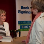 Sally Magnusson signs copies of her book for Book Festival audience members |