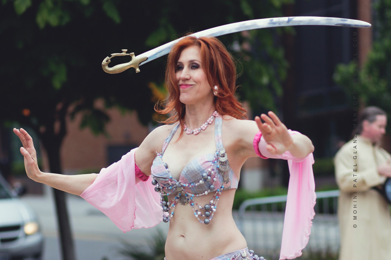 Mellilah  NW Belly Dancer balancing a sword on her head