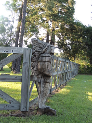 wood light sunset usa texas shadows feathers carving woodenfence pinetrees headdress hff montgomerycounty woodenindianchief