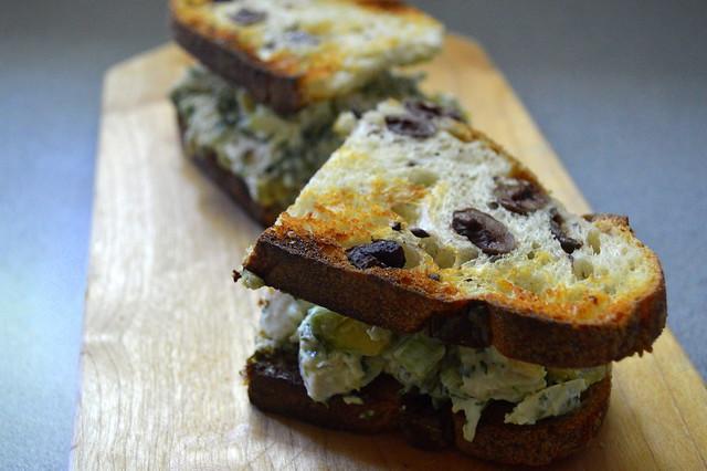 Lemon and avocado chicken salad on toasted kalamata olive bread