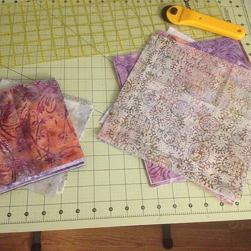 Finally getting around to cutting the fabric for my mom's quilt. She said she wanted lavender and gray, which after being translated in my head and many, many fabric auditions, turned into a range of purple and cream #batiks. #quilt #quilting #quiltplanni