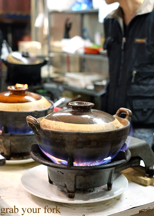 Gas flames cooking clay pot rice at Tai Chung Wah, Cheung Sha Wan, Hong Kong