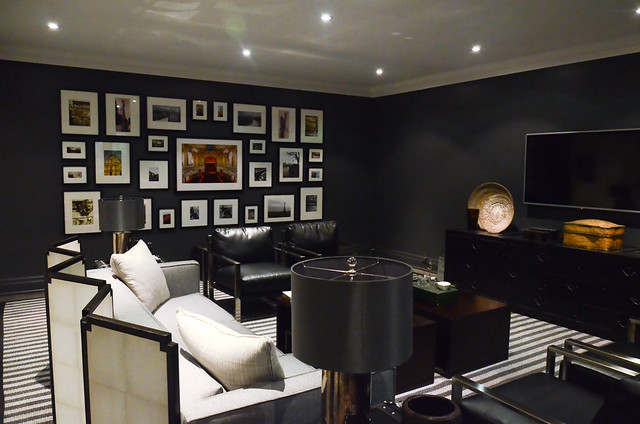 Black recreational room with a travel inspired gallery wall, Princess Margaret Showhome in Oakville by Brian Glucktein
