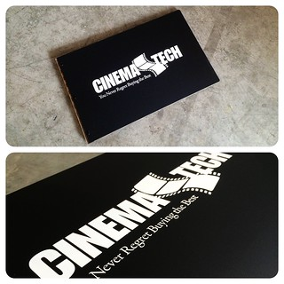 Custom portfolio book in matte black acrylic with engraved white color fill treatment