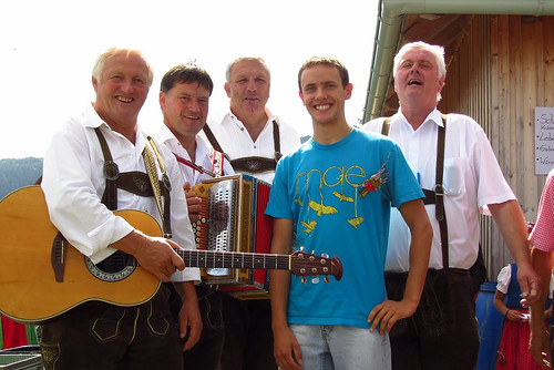 A student poses with a traditional band in Germany.