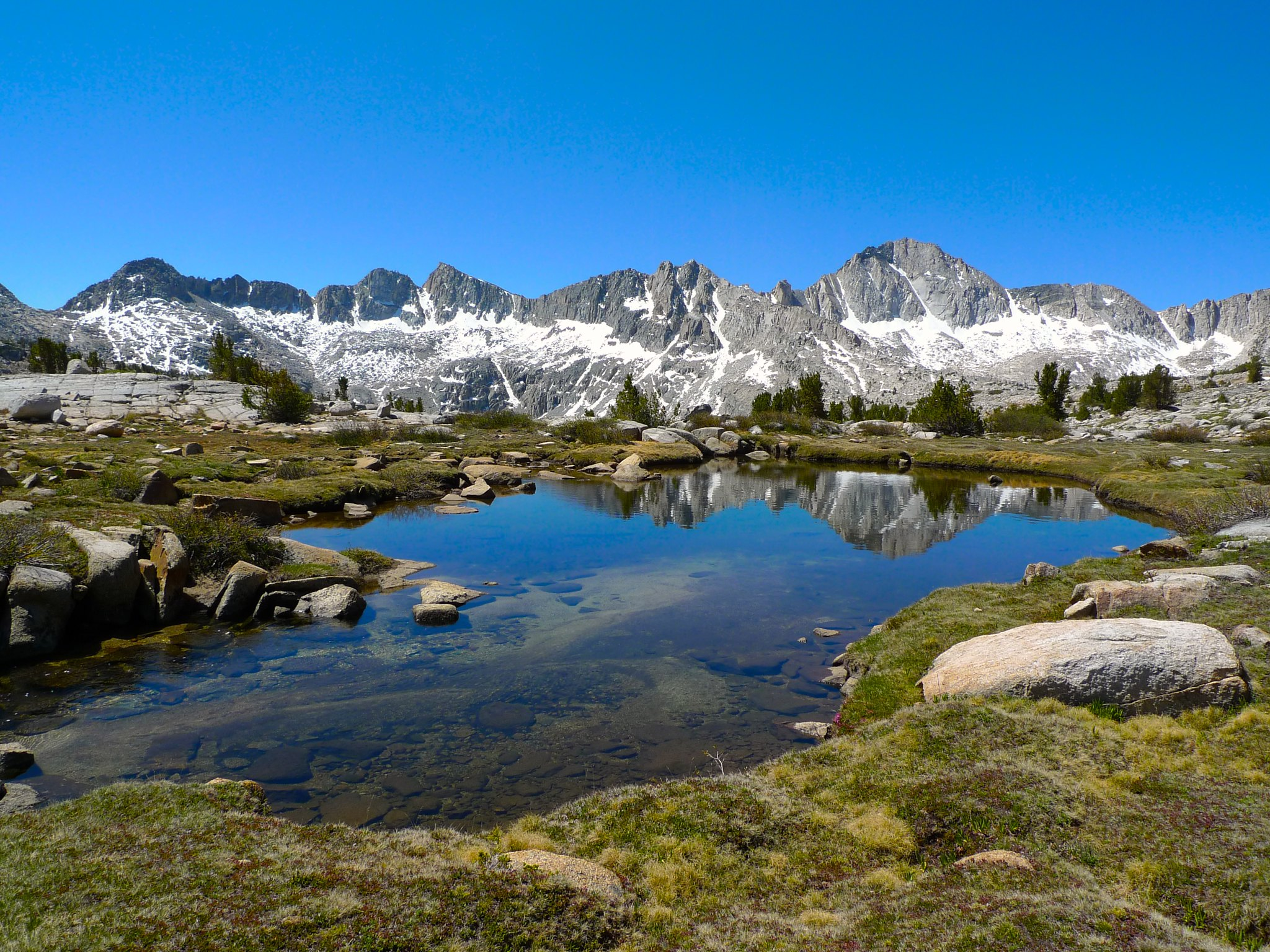 Surreal ponds surrounded by impressive peaks in Dusy Basin