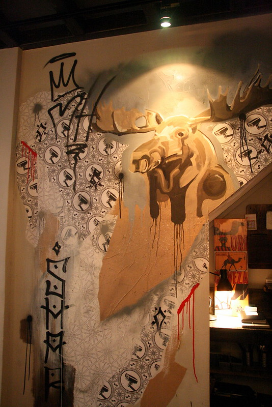 Chef Manel painted a moosehead on the wall which also features a collage mural by Samantha Lo