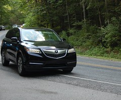 executive car(0.0), saab 9-4x(0.0), automobile(1.0), automotive exterior(1.0), sport utility vehicle(1.0), wheel(1.0), vehicle(1.0), automotive design(1.0), compact sport utility vehicle(1.0), crossover suv(1.0), acura mdx(1.0), bumper(1.0), land vehicle(1.0), luxury vehicle(1.0), acura(1.0),