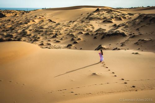 Sand shadow sea and she
