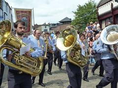 sousaphone(0.0), festival(1.0), musician(1.0), tuba(1.0), musical instrument(1.0), brass instrument(1.0),