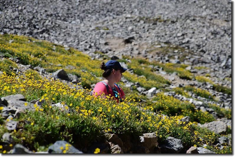 Hiker is taking a break at the Grays Peak trail