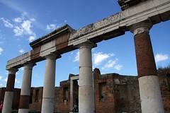arch(0.0), aqueduct(0.0), temple(0.0), ancient greek temple(0.0), travel(0.0), ancient roman architecture(1.0), ancient history(1.0), historic site(1.0), landmark(1.0), architecture(1.0), roman temple(1.0), ruins(1.0), ancient rome(1.0), column(1.0),