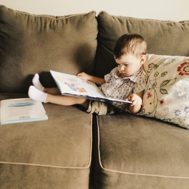 This is what he does when I start to vacuum. #instaluther #bookworm #toddler #children #reading #idontdochores