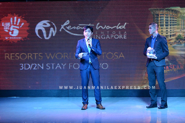 GIVE ME 5 RAFFLE PRIZE. Owen Cammayo, newly appointed Director for Corporate Communications, Resorts World Manila, called out the name of the winner for the Resorts World Sentosa 3D/2N stay for two.