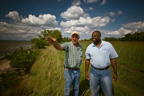 A district conservationist with NRCS (right) works with a Maryland farmer to discuss conservation options for his farm that include improving water quality in the Chesapeake watershed. NRCS photo.