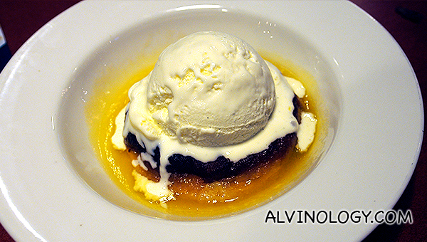 Bread Pudding, served with vanilla ice cream and whiskey sauce - S$9.90