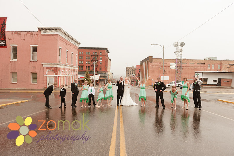 bridal party poses in street for a photo