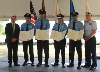 The boat crew of a Puerto Rico Police Joint Forces of Rapid Action (FURA) marine unit COBRA-62 presented with the Coast Guard Meritorious Public Service Award June 13, 2014 at Sector San Juan, after being recognized for their heroic actions Nov. 8, 2013, while rescuing the crew of a Coast Guard response boat that capsized in the breaking surf off the Condado Lagoon in San Juan, Puerto Rico, while searching for two swimmers in distress.  From left to right are: José Caldero López, Puerto Rico Police Superintendent, followed by the crew of the FURA marine unit, Agents Francisco Ávila Rivera and Gabriel Roldán García, Sergeant Wilberto Pérez de La Torre and Agent Bienvenido Marín Rivera.  To the far right of photo is Capt. Drew W. Pearson, commander of Coast Guard Sector San Juan. (Coast Guard photo by Coast Guard Auxiliarist Vicente Vélez).