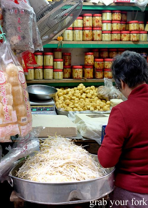 Mung bean sprouts, fresh tofu and preserved tofu at the Graham Street market, Central district, Hong Kong