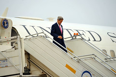 U.S. Secretary of State John Kerry disembarks from his plane after arriving at Palam Air Force Base in New Delhi, India, on July 30, 2014, for a Strategic Dialogue with Commerce Secretary Penny Pritzer. [State Department photo/ Public Domain]