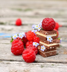 Fresh raspberries with chocolate cubes
