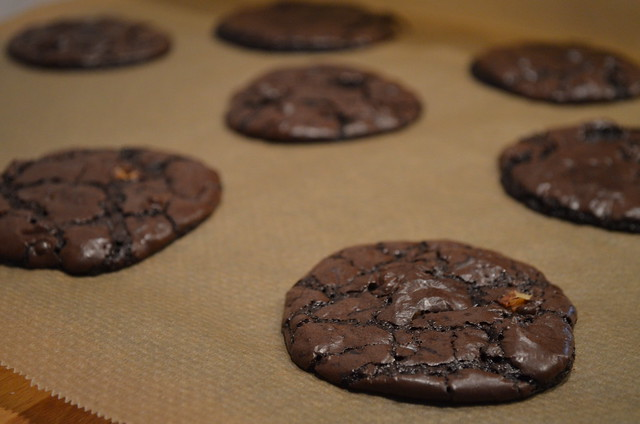 Chocolate Brownie Cookies Bon Appetit cooling on baking paper close-up