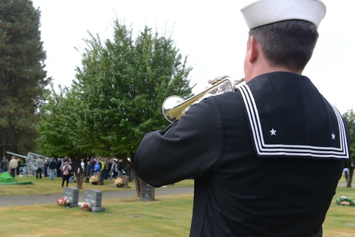 A bugler performs Taps during a memorial ceremony for Coast Guard Signalman 1st Class Douglas Munro held at his gravesite in Cle Elum, Wash., Sept. 26, 2014. Each year, a ceremony is held to honor Munro on the anniversary of his death. (U.S. Coast Guard photo by Petty Officer 3rd Class Katelyn Shearer)