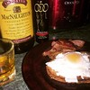 Breakfast for lunch.  Toasted Dave's Killer Powerseed(r) Bread with four pepper goat cheese topped with basted egg, drizzled with Olympia Olive Oil Raspberry Balsamic Vinaigrette served with accompaniment of Fried Prosciutto and a neat Canadian Whisky.  #